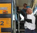 CHILD STEPPING OFF BUS MIAMI HERALD